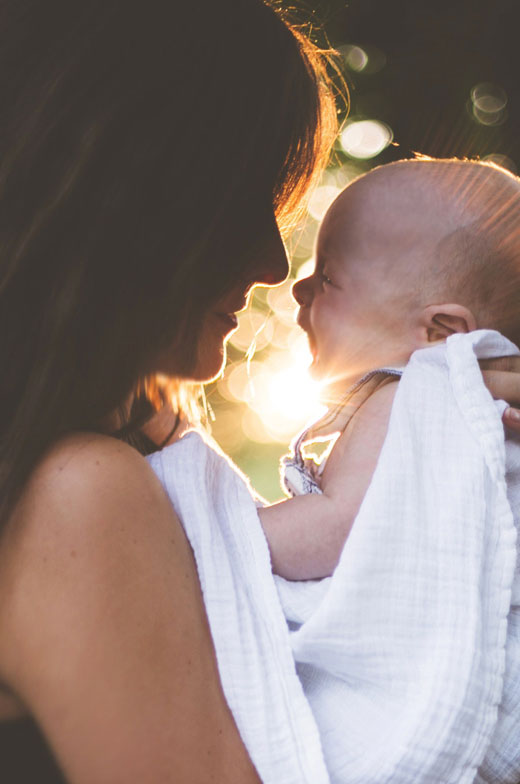mom-holding-baby_boise-surrogacy-agency